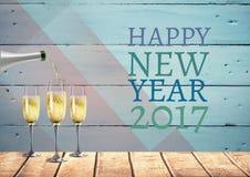Lyckligt nytt år 2017 önskar med exponeringsglas och flaskan för champagne 3D Arkivbild