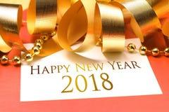 Lyckligt nytt år 2018 med guld- garnering arkivfoto