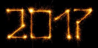 Lyckligt nytt år - 2017 med tomtebloss på svart Arkivfoto