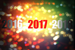 Lyckligt nytt år 2017 på bokehsuddighetsbakgrund Fotografering för Bildbyråer
