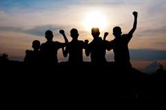 Lyckligt och seger tillsammans Fotografering för Bildbyråer