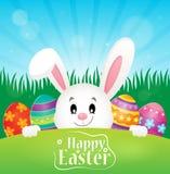Lyckligt påsktema med ägg och kaninen Arkivfoto