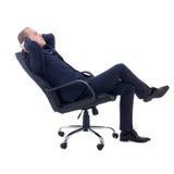 Lyckligt sammanträde för affärsman på kontorsstol som isoleras på vit Arkivfoto