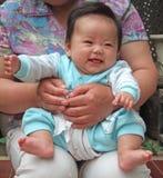 lyckligt spädbarn Arkivfoto