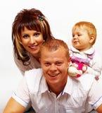 Lyckligt ungt skratta för familj fotografering för bildbyråer