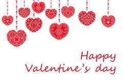 Lyckligt Valentineas dagbegrepp med lyckönskantext Romantiska röda hjärtor formar med dekorativt snör åt den blom- prydnaden Arkivfoto