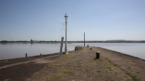 Lydney harbour jetty view across the River Severn estuary towards Berkely and Sharpness Gloucestershire uk pan stock footage