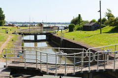 Lydney harbour lock gates Gloucestershire England uk with boats in summer Stock Images