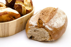 Lye bread rolls and wheat bread Royalty Free Stock Photography