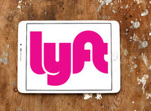 Lyft logo. Logo and icon of lyft taxi company on samsung tablet on wooden background Stock Photo