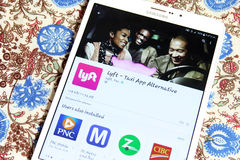 Lyft taxi app on google play. Downloading lyft taxi application from google play on samsung tab s2 Stock Image