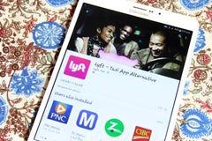 Lyft taxi app on google play Stock Image