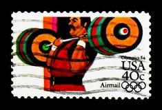 Lyfta för vikt, OS 1984 - Los Angeles serie, circa 1983 Arkivfoton