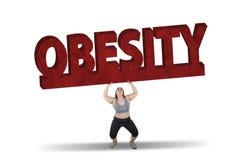 Lyftande fetmaord för fet kvinna Fotografering för Bildbyråer