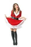Lyftande klänning för skämtsam glad jultomtenkvinna som ser kameran arkivbilder