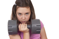 Lyftande vikt för tonårs- flicka Fotografering för Bildbyråer