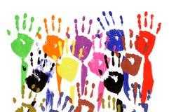 Lyftta händer i akrylmålarfärg Arkivbild
