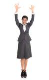 Lyftta indiska armar för affärskvinna royaltyfria foton