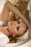 Lying attractive young girl. Attractive young girl is lying on the white counterpane Stock Image