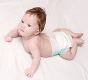 Lying baby Stock Images
