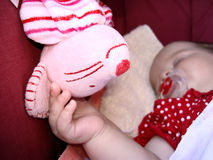 Lying baby. In the dark red baby carriage stock photos