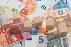 Lying bank notes with wooden dices Stock Images