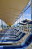 Lying-battery. A row of beach-chairs with sun-protection on a beach at the adria-coast, Italy stock photos
