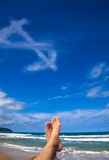 Lying on the beach with dollar symbol. Cloud stock images