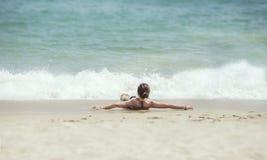 Lying on the beach Stock Photography