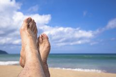 Lying on the beach  watching my feet Royalty Free Stock Photography