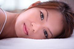 Lying on the bed 2 Stock Images