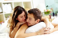 Lying in bed Stock Photography