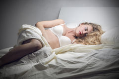 Lying in bed Royalty Free Stock Photography