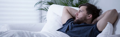 Lying in bed with open eyes Stock Photos