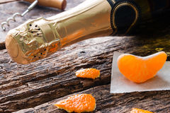 Lying a bottle of champagne Royalty Free Stock Images