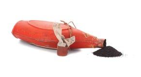 Lying bottle with gunpowder,. White background Stock Photo