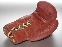 Lying Boxing Glove. Used boxing glove lying on the backside Royalty Free Stock Photos