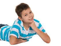 Lying boy looks forward Royalty Free Stock Photography