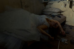 Lying bride in bed. Creepy bride in creepy devastated room royalty free stock photos