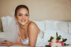Lying bride portrait Stock Images