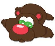 Lying brown bear Stock Photo