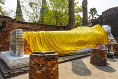 Lying Buddha dressed in yellow scarf in temple Wat Yai Chai-mong Stock Images