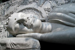 Lying Buddha marble statue Royalty Free Stock Images