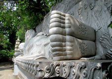 Lying Buddha marble statue feet Royalty Free Stock Photos