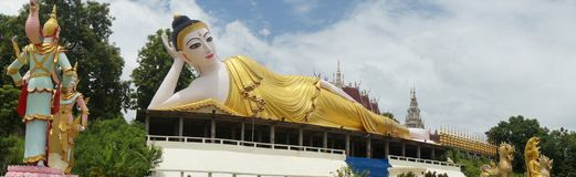 Lying buddha in a newly built temple in thailand. Lying buddha in a newly built temple Royalty Free Stock Photos