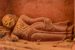 Lying Buddha statue in Bagan temple, Myanmar. Lying Buddha statue in a temple in Bagan, Burma, Myanmar Stock Photo