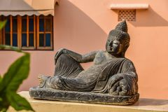 Lying Buddha stone sculpture stock photo