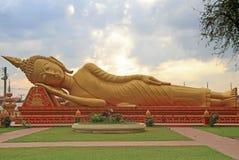 Lying buddha in wat that luang tai Stock Photo