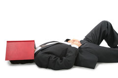 Lying businessman with book on face Royalty Free Stock Photography