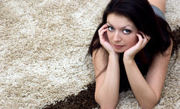 Lying on carpet Stock Photos